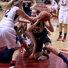MARY SCHWALM/Staff photo Andover's Alyssa Casey (33) looks to pass from the floor after recovering a loose ball during their basketball game against Central Catholic in Lawrence.  1/9/14