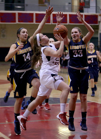 MARY SCHWALM/Staff photo Central Catholic's Colleen Frey (20) drives to the basket against Andover defenders Rebecca Alois (14) and Alyssa Casey (33) during their basketball game in Lawrence.  1/9/14