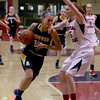 MARY SCHWALM/Staff photo Andover's Jessica Witten drives against Central Catholic's Erica Hadad during their basketball game in Lawrence.  1/9/14