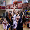 MARY SCHWALM/Staff photo Central Catholic's Amanda Williams gets a shot up despite the efforts of Andover defenders Rebecca Alois, left, and Colleen Caveney during their basketball game in Lawrence.  1/9/14