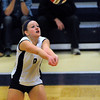 CARL RUSSO/Staff photo. Andover high was defeated by Newton North high in state volleyball semifinals Tuesday night. Andover's Lauren Gibson keeps the ball in play. 11/13/2012.