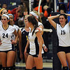 CARL RUSSO/Staff photo. Andover high was defeated by Newton North high in state volleyball semifinals Tuesday night. Andover players including Marcela Familiar-Bolanos (24) and Becky Hoffman (15) start to walk off the floor after being defeated.  11/13/2012.
