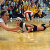 CARL RUSSO/Staff photo. Andover high was defeated by Newton North high in state volleyball semifinals Tuesday night. After Andover's Marcela Familiar-Bolanos (center) dived to the floor to keep the ball in play, she watches her teammate Lauren Gibson make the same attempt but without success. 11/13/2012.