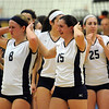 CARL RUSSO/Staff photo. Andover high was defeated by Newton North high in state volleyball semifinals Tuesday night. Andover's Lauren Gibson (8) and Becky Hoffman (15) walk off the floor after the team was defeated. 11/13/2012.
