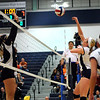 CARL RUSSO/Staff photo. Andover high was defeated by Newton North high in state volleyball semifinals Tuesday night. Andover's Elizabeth Wait spikes the ball over the net. 11/13/2012.