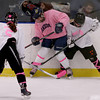 Andover's Brenna Keefe, center, and Beverly/Danvers Nicole Woods, right, make a play for the puck along the boards as Beverly/Danvers Kristen McCarthy (5) looks for a rebound. Photo by Mary Schwalm