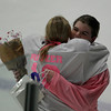 Andover hockey player Laura Ritzer, right, gets a hug from Beverly/Danvers player Rachel Ingraham after receiving flowers and gift bag before the start of their game in Andover.  The teams wore pink and white jerseys wtih Ritzer on the back in memory of Laura's sister Colleen.  Photo by Mary Schwalm