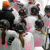 Beverly/Danvers players listen to their coach during a timeout in their game against Andover. The team joined Andover in a game honoring Colleen Ritzer by wearing pink and white jerseys with Ritzer as the name plate.  Photo by Mary Schwalm