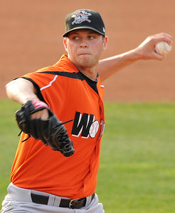 Former Vermilion High pitcher Andy Oliver delivers a pitch last night against the Akron Aeros. DAVID RICHARD / CHRONICLE