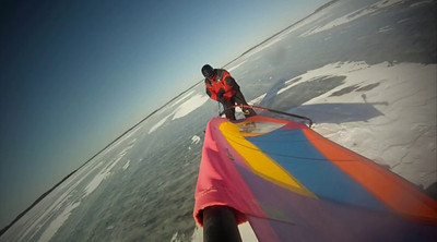 Ice Boarding, or Windsurfing on Ice.  These videos were all captured using GoPro HD Hero Camera's.  The ice on Lake Mendota is rarely this pristine, especially mid season.  The small GoPro cameras are fantastic at capturing different angles.  Mounts used:  Tripod mount, Front facing helmet mount, and Bike seat post mount.