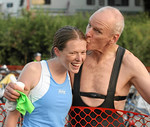 Another tri stud (my dad) kissing me before he starts his swim.