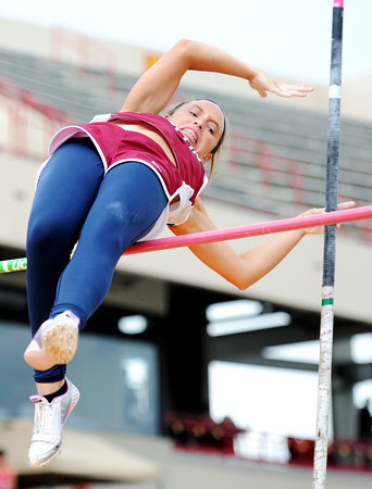 Globe/T. Rob Brown<br /> Joplin senior Holly O'Dell barely clears the bar on a vault Friday afternoon, April 13, 2012, at Pittsburg State University's field.