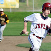 Globe/T. Rob Brown<br /> Joplin's (1) heads to third base before heading for home to score a run against Kickapoo Tuesday afternoon, April 10, 2012, at Joe Becker Stadium.
