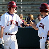 Globe/T. Rob Brown<br /> Joplin's Nathan Brummer (left) is congratulated by a teammate while returning to the dugout after scoring a run against Kickapoo Tuesday afternoon, April 10, 2012, at Joe Becker Stadium.