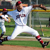 Globe/T. Rob Brown<br /> Joplin's (22) pitches against Kickapoo Tuesday afternoon, April 10, 2012, at Joe Becker Stadium.
