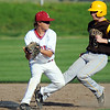 Globe/T. Rob Brown<br /> Joplin infielder (14) gets Kickapoo runner (5) out at second base Tuesday afternoon, April 10, 2012, at Joe Becker Stadium.