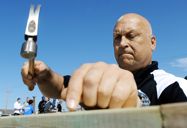Globe/T. Rob Brown<br /> Major League Baseball Hall of Famer Cal Ripken Jr. hammers a nail as he helps build a Habitat for Humanity home Wednesday morning, April 18, 2012, in the 2400 block of South Wall Avenue, Joplin. Ripken's charitable organization Cal Ripken Sr. Foundation (named for his father), Habitat for Humanity and the Bunny Brigade with Energizer joined forces to replace one of the homes destroyed by the May 22, 2011, tornado.