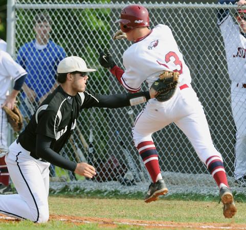 Globe/Roger Nomer<br /> Willard's Jed Owen tags out Joplin's Keith Simpson at first base during Friday's game.