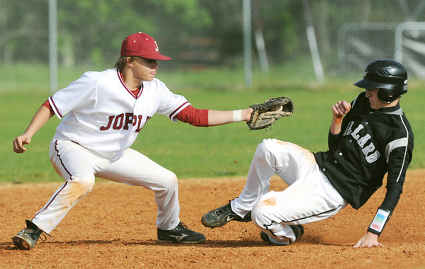 Globe/Roger Nomer<br /> Joplin's Chris Leonardi tags out Willard's Cole Teaford during a steal attempt in Friday's game.