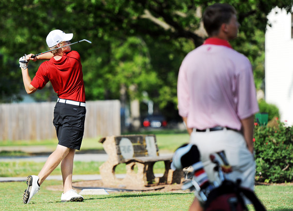 Globe/T. Rob Brown<br /> Joplin's Griffen Locke tees off on the 8th hole as Webb City's Ben Starkey looks on Wednesday afternoon, April 4, 2012, at Briarbrook Country Club.