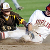 Globe/T. Rob Brown<br /> Joplin's (31) slides into second base against Kickapoo infielder (3) Tuesday afternoon, April 10, 2012, at Joe Becker Stadium. The runner was called out on the play.