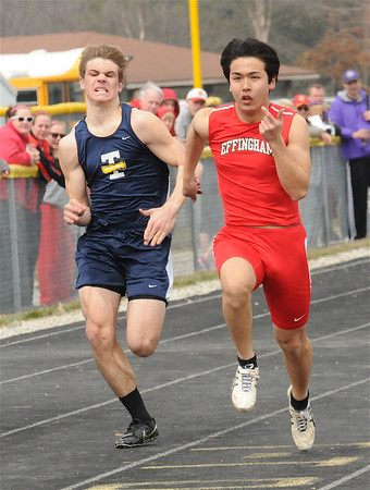 Effingham's Kohdai Nishida and Teutopolis' Kyle Blievernicht race to the finish line in the 100-meter dash.