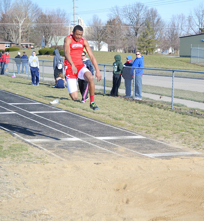 Effingham's Marcus Robinson soars toward the sand pit during the triple jump competition at Teutopolis' tri-meet.