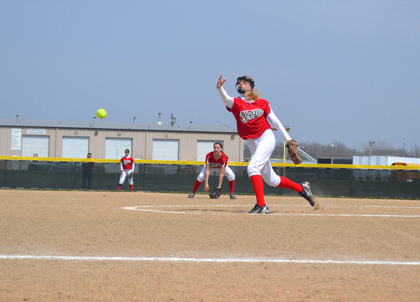 Effingham's Hope Collier strides toward home plate as her pitch flies toward a Charleston batter during game one of the Hearts' conference doubleheader against the Charleston Trojans.