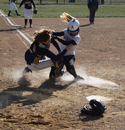 Altamont's Lauren Ohnesorge collides with Teutopolis catcher Anni Borries on a play at the plate during the fourth inning of the two teams' first game. Ohnesorge was ruled safe on the play after the ball slipped loose.