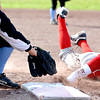 Effingham pinch runner Katie Roberts slides back in to first base under the tag of Cumberland first baseman Kyla Thornton during a 10-2 loss.