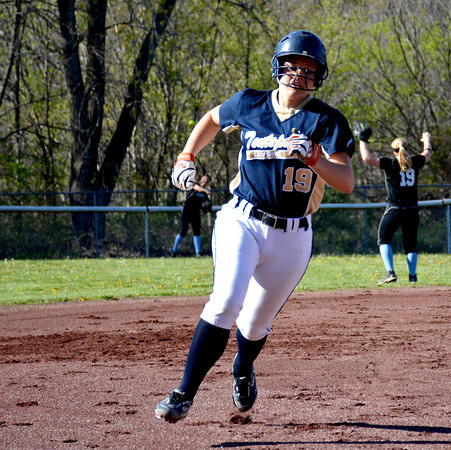Teutopolis' Anni Borries rounds third base and scores while a throw from Cumberland's Kaylee Carlen flies through the air to Taylor Layton.