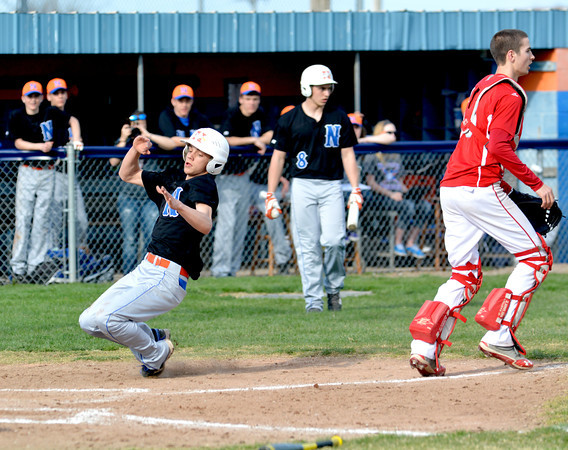 Newton's Nate Meinhart slides in safely to home in a loss to Marshall.