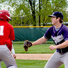 South Central first baseman Kyle Bray reaches to tag Effingham's Kevin Daugherty on a ground out during Effingham's 3-1 win.