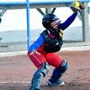 St. Anthony catcher Hunter Niebrugge reaches and corrals a pitch out of her stance during a win at Newton.