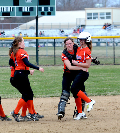 Altamont's Lauren White (center) lifts up Brooke Burns after a walk-off hit to lead Altamont over Cumberland.