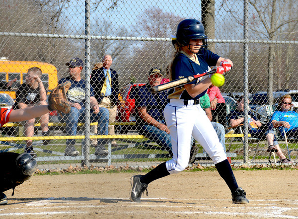 Teutopolis' Madison Cowman makes contact on a line drive during a 9-5 win over Altamont.