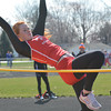 Effingham's Chandler Ramey attempts to clear the high jump bar at Teutopolis Junior High.