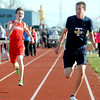 Teutopolis' Lucas Probst takes a quick peek at Effingham's Josh McCammon as they sprint the last 20 meters to the finish line during the 3200-meter run at Effingham High School.