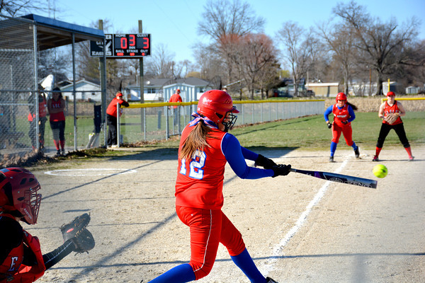 St. Anthony's Kristen Schuette smacks a hit during the third inning of a 21-2 win over Beecher City/Cowden-Herrick.