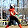 Altamont's Lauren White drives the ball off her bat in a loss at Teutopolis.