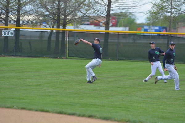 Windsor/Stew-Stras right fielder Bryse Bugger makes a catch and comes up throwing on a sacrifice fly against St. Anthony.
