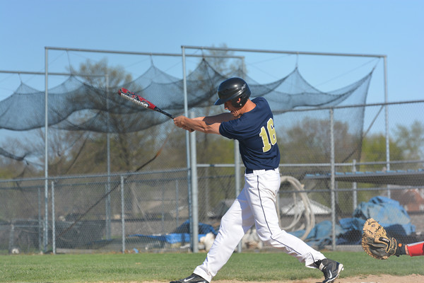 Teutopolis' Justin Kenter takes a swing during a 6-0 win over Mt. Zion.