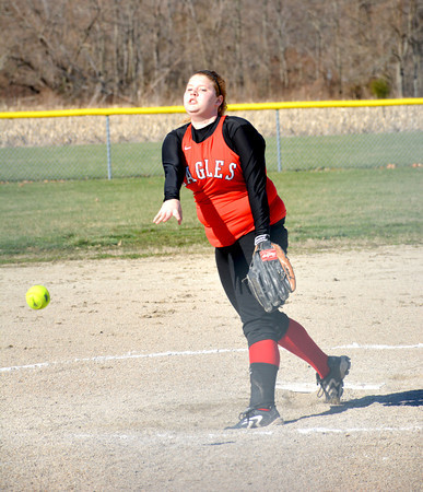 Beecher City/Cowden-Herrick's Kirby Herrmann watches her pitch soar toward home in a loss against St. Anthony.