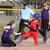 4-1-15<br /> Kokomo vs Northwestern softball<br /> Kokomo's Alexis Clark gets to second safely after Bailey Thatcher misses the catch.<br /> Kelly Lafferty Gerber | Kokomo Tribune