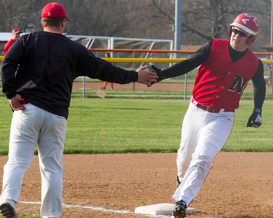 Neoga's Caleb Hill rounds third base after hitting a solo home run in the third inning at Charleston.