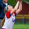 St. Anthony's shortstop Jenna Woltman eyes an infield fly ball during a game against Paris.