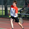 Effingham's Aaron Conley prepares to hit a forehand during a match against St. Anthony.