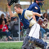 Teutopolis catcher Drew Thoele looks for a passed ball during a contest against St. Anthony.