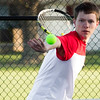 Effingham's Aaron Conley prepares to take a forehand cut during a match at Mattoon.