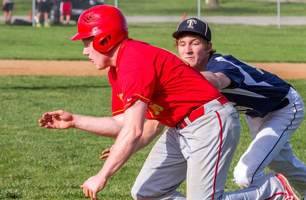 Teutopolis' Devin Smith tags out Charleston's Sam Gubbins at third base during the second inning.